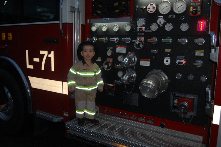 Blake on Ladder Truck.jpg